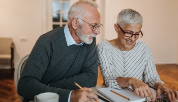 Elderly couple looking at finances